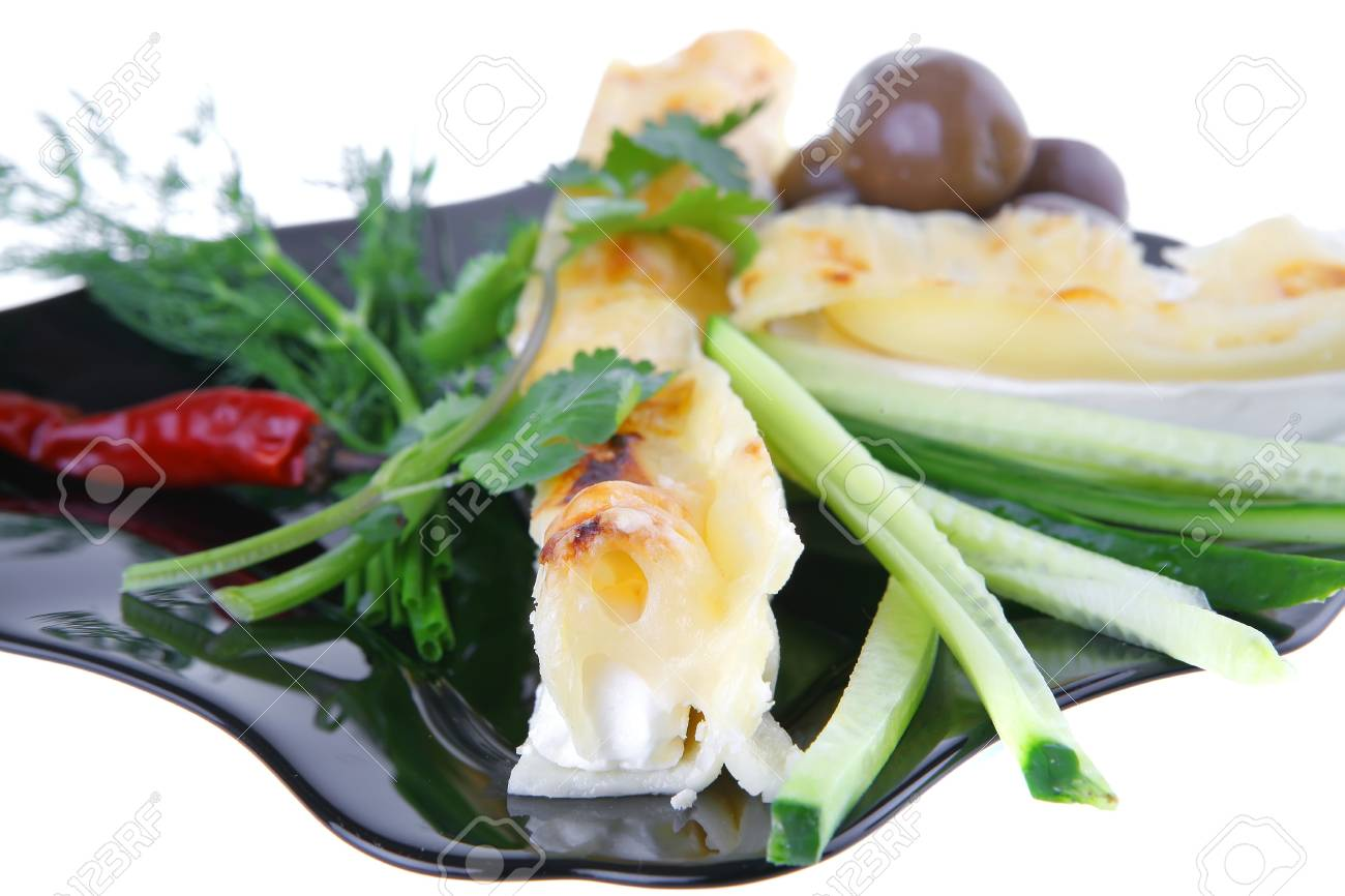 cheese cannelloni served with pepper and olives on black plate Stock Photo - 7385806