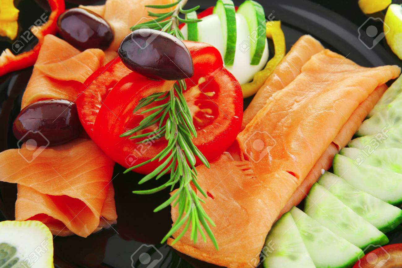 image of served salmon slices with tomatoes and peppers - 7483524