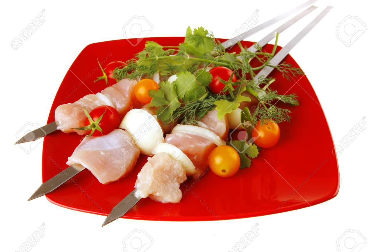 raw  chicken kebabs served with cherry and greenery Stock Photo - 7633032