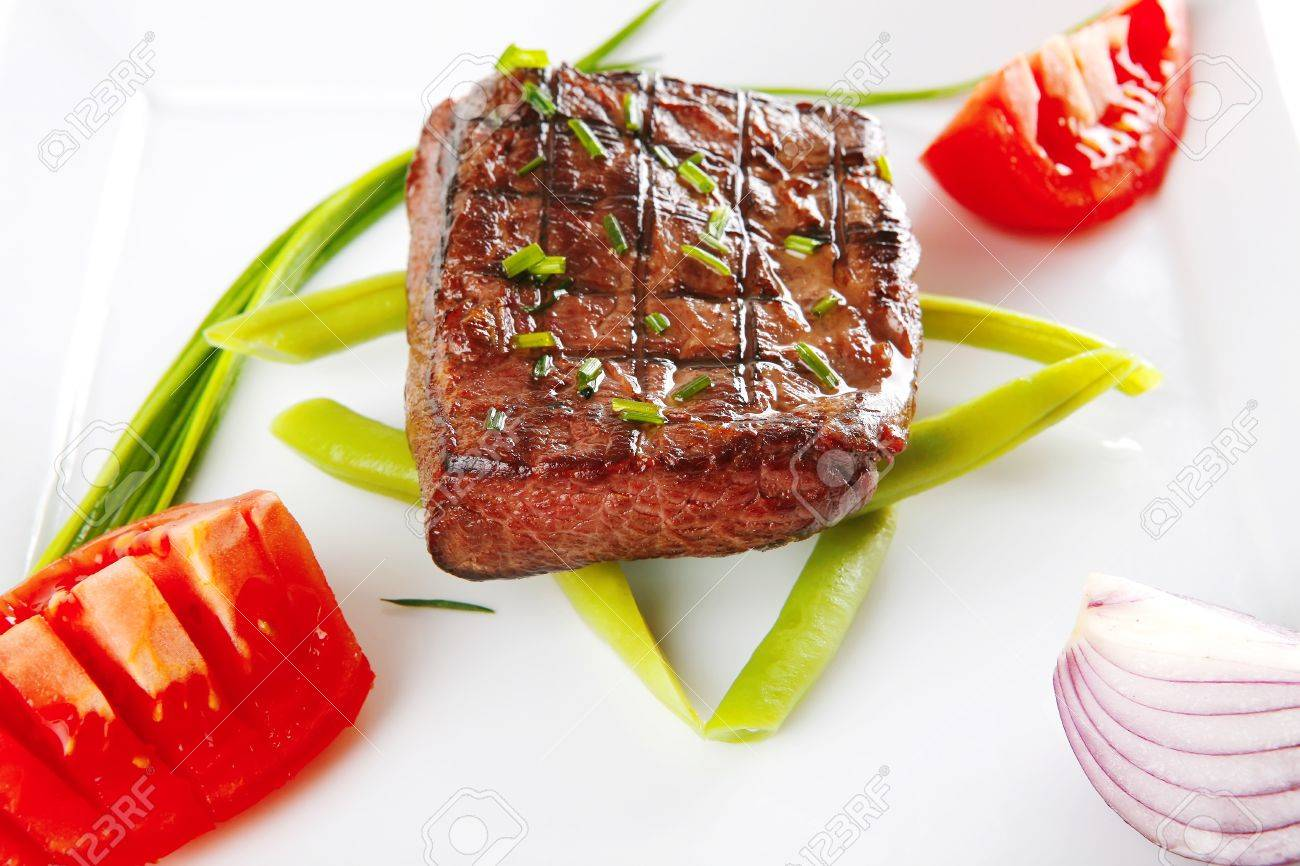 roast beef fillet served with tomato on white Stock Photo - 7643484