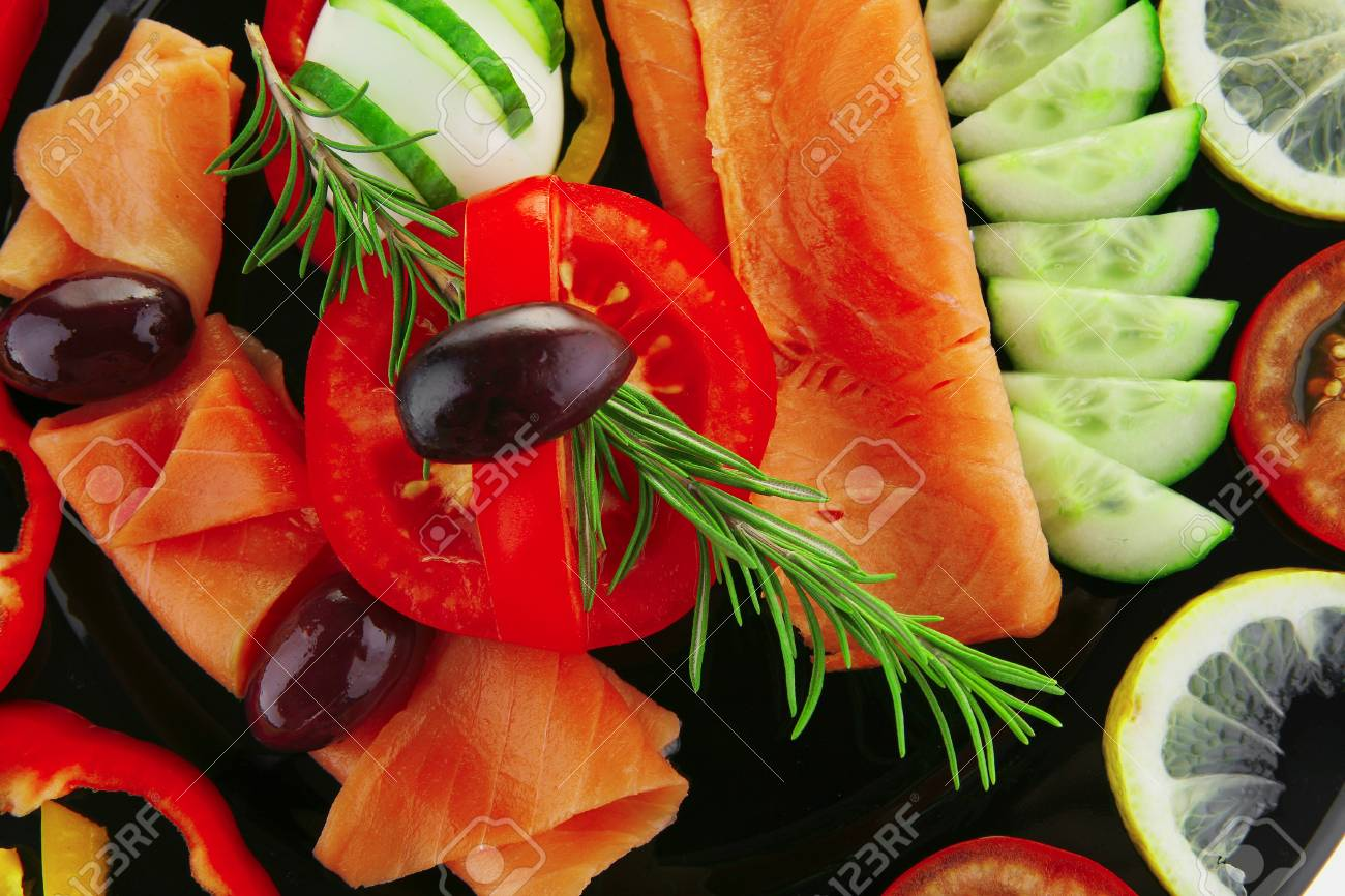 image of served salmon slices with tomatoes and peppers - 7878932