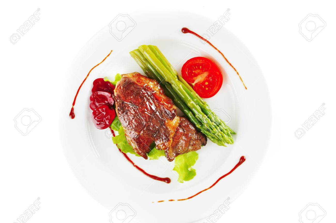 Beef Meat Served On White Plate With Asparagus Stock Photo 7894562