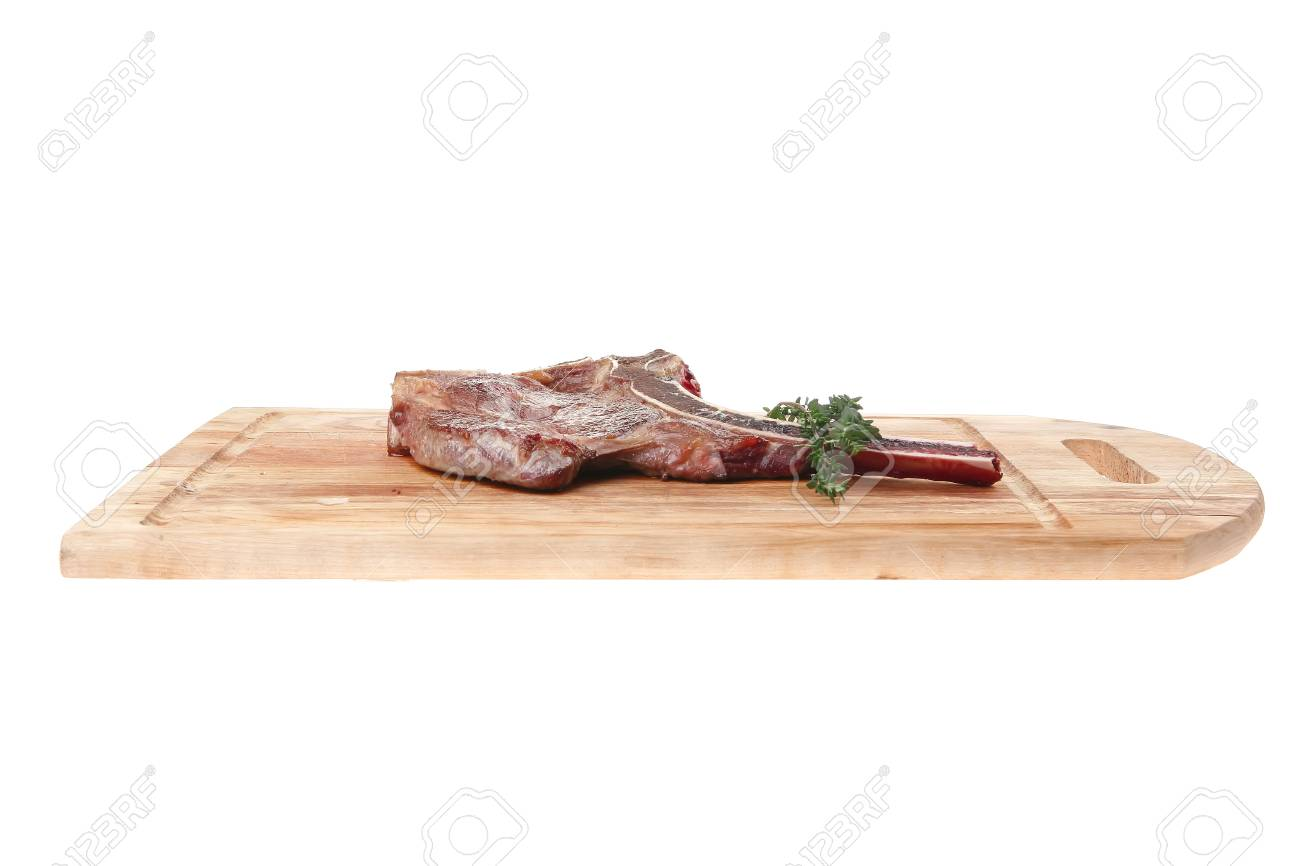 meat food : roast rib on wooden plate with thyme isolated over white background Stock Photo - 8917811