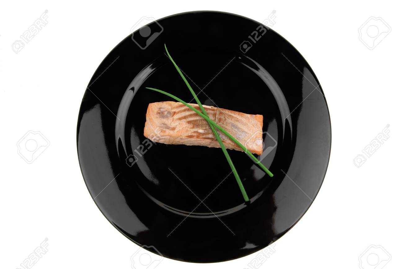 savory fish portion : norwegian salmon fillet roasted with green chinese onion, on black dish isolated over white background Stock Photo - 10056607