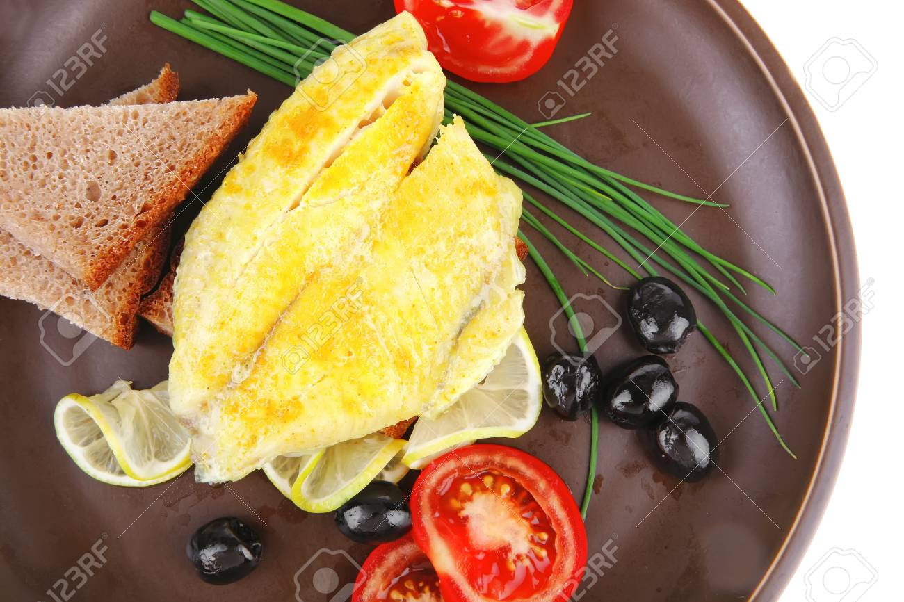 grilled fish fillet served with tomatoes,olives and bread Stock Photo - 11530458