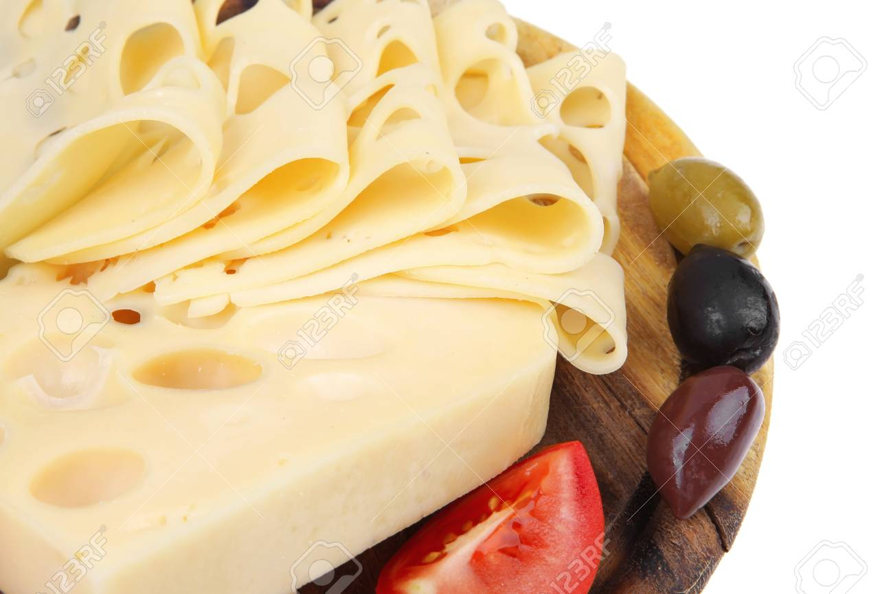 yellow swiss cheese sliced on wooden platter with olives and tomato isolated over white background Stock Photo - 12110637