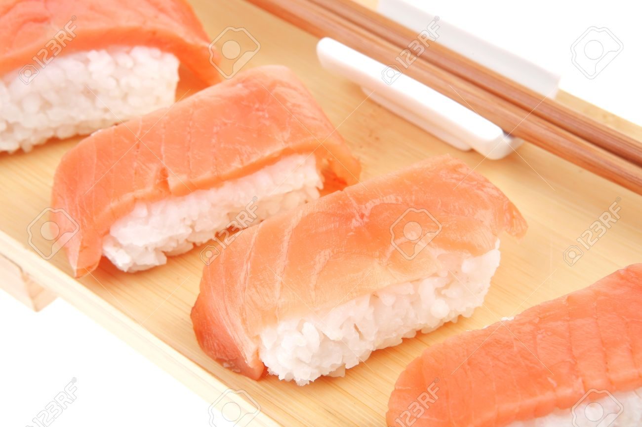 Nigiri Sushi , Set of Nigiri sushi topped with raw Salmon . Isolated over  white background