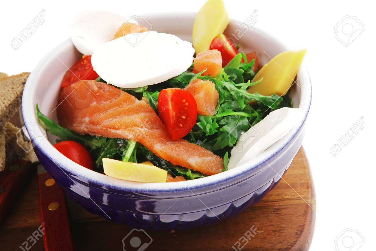 green salad with smoked salmon and bread on wood Stock Photo - 12713254