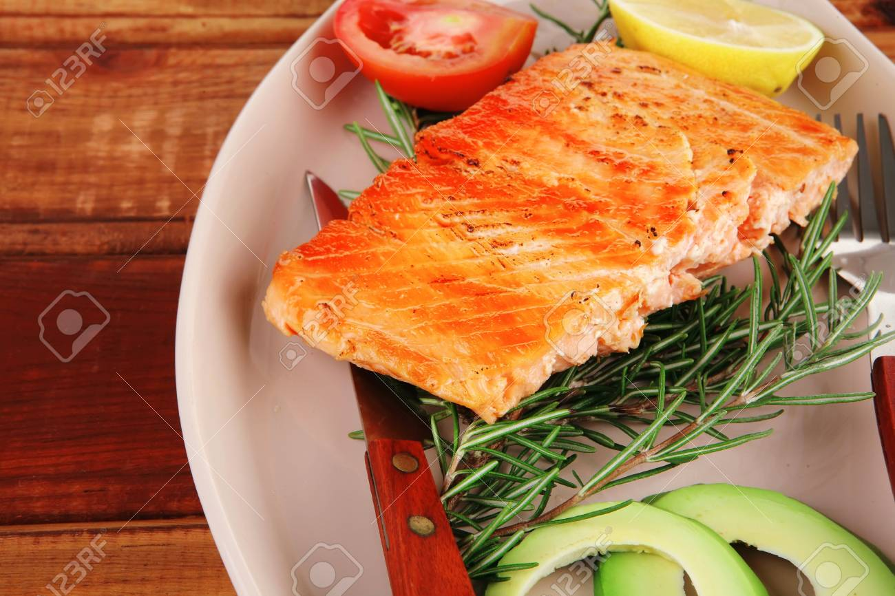 served fish: roast salmon fish over glass plate over wood Stock Photo - 13028866