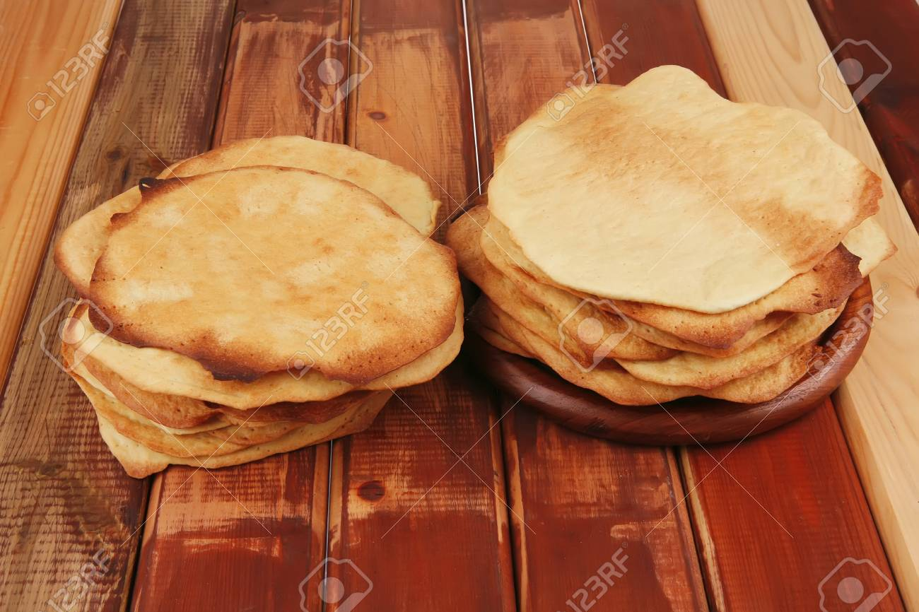 big pile of baked cakes over wooden table Stock Photo - 13316663