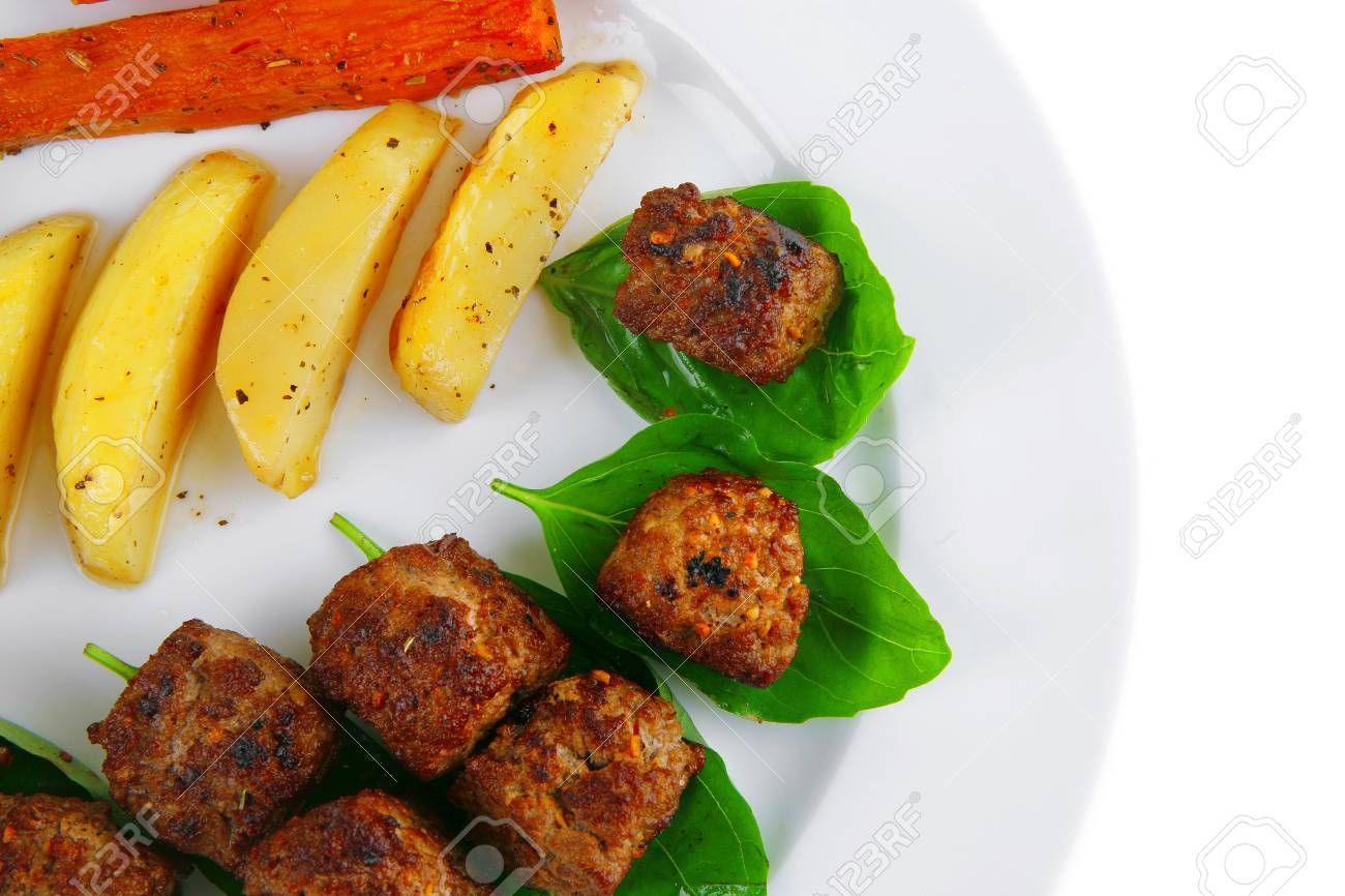 grilled beef meatballs with baked potatoes on white Stock Photo - 14449319