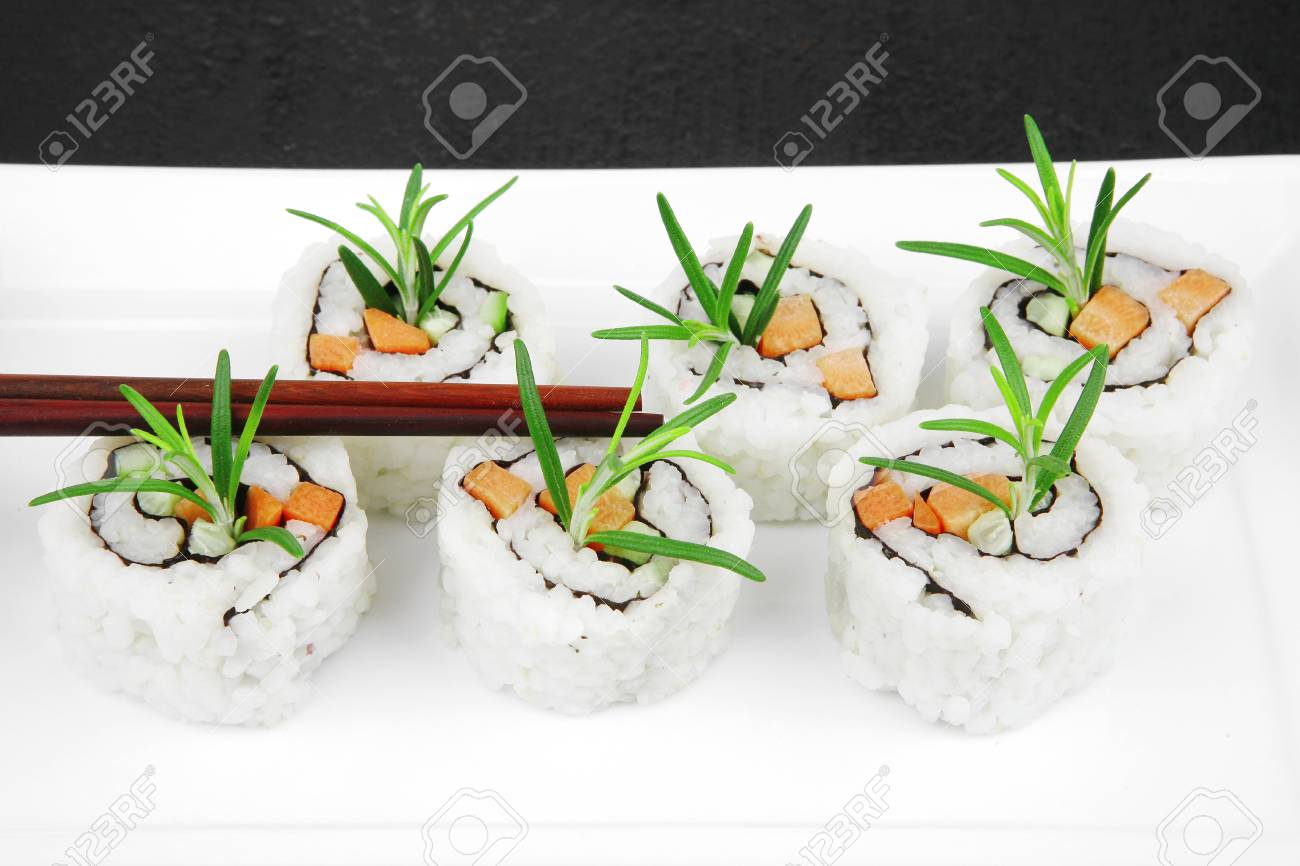 Maki Sushi - California Roll made of Smoked salmon, Cream Cheese and Deep Fried Vegetables inside. With wasabi and ginger. on black table Stock Photo - 14672448