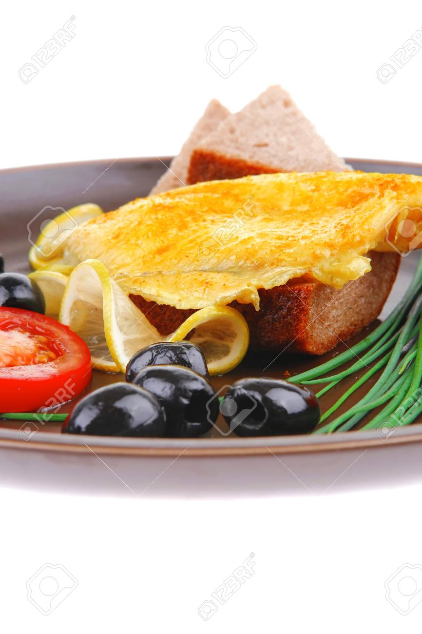 roast fish fillet with tomatoes,chives and bread on plate Stock Photo - 17071578
