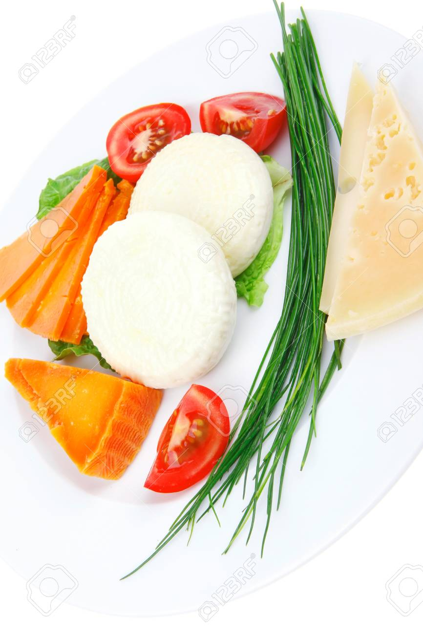 french cheeses : delicatessen aged cheeses with soft feta chops served on white plate with slices isolated on white background Stock Photo - 17460416