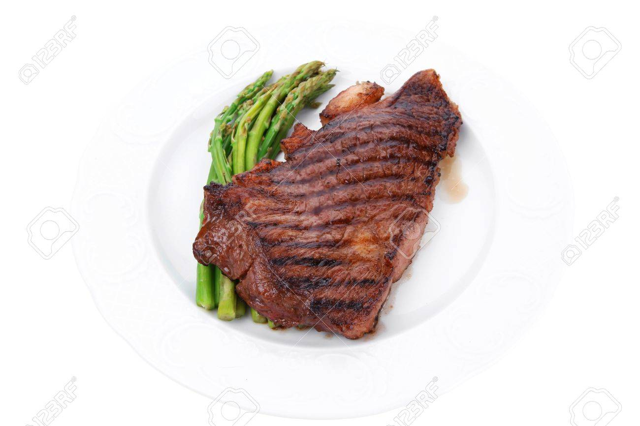 Beef Steak On Plate With Asparagus Isolated On White Stock Photo 27611418