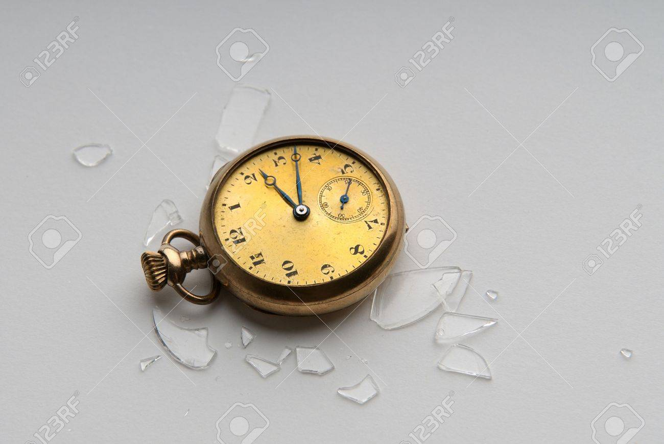 Close-up image of an antique gold watch with shattered crystal Stock Photo - 4270391