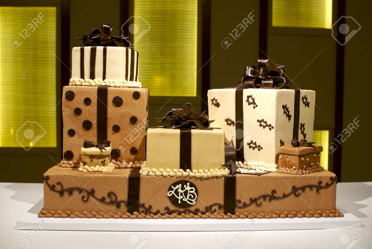Image Of A Brown And White Wedding Cake With Multiple Layers ...
