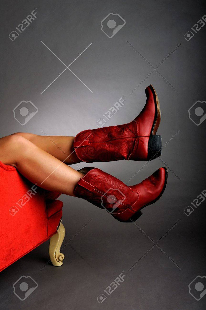 Red chair photography - Image Of A Pair Of Legs Hanging Off A Red Chair Wearing Red Cowboy Boots Stock