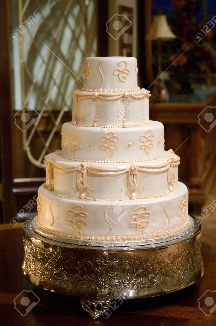 classic wedding cake with gold icing stock photo 6218722
