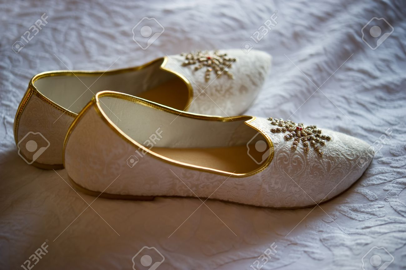 Mens Wedding Shoes.Image Of Men S Indian Wedding Shoes On A Bed