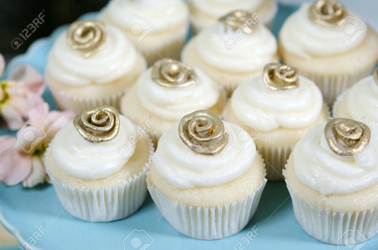 Image of beautifully decorated wedding cupcakes on a plate Stock Photo -  13493937