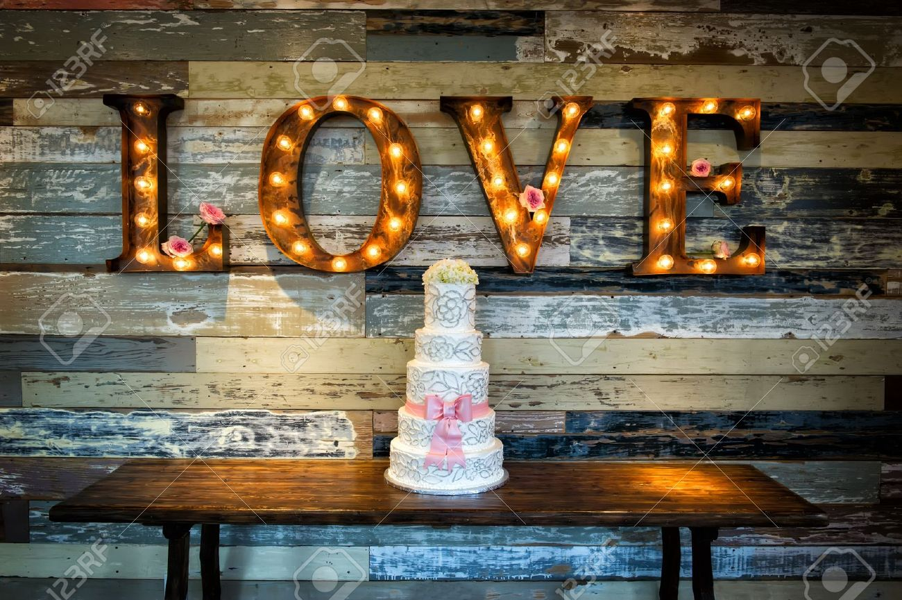 a wedding cake with the word love as sinage on a rustic background Stock Photo - 22108584