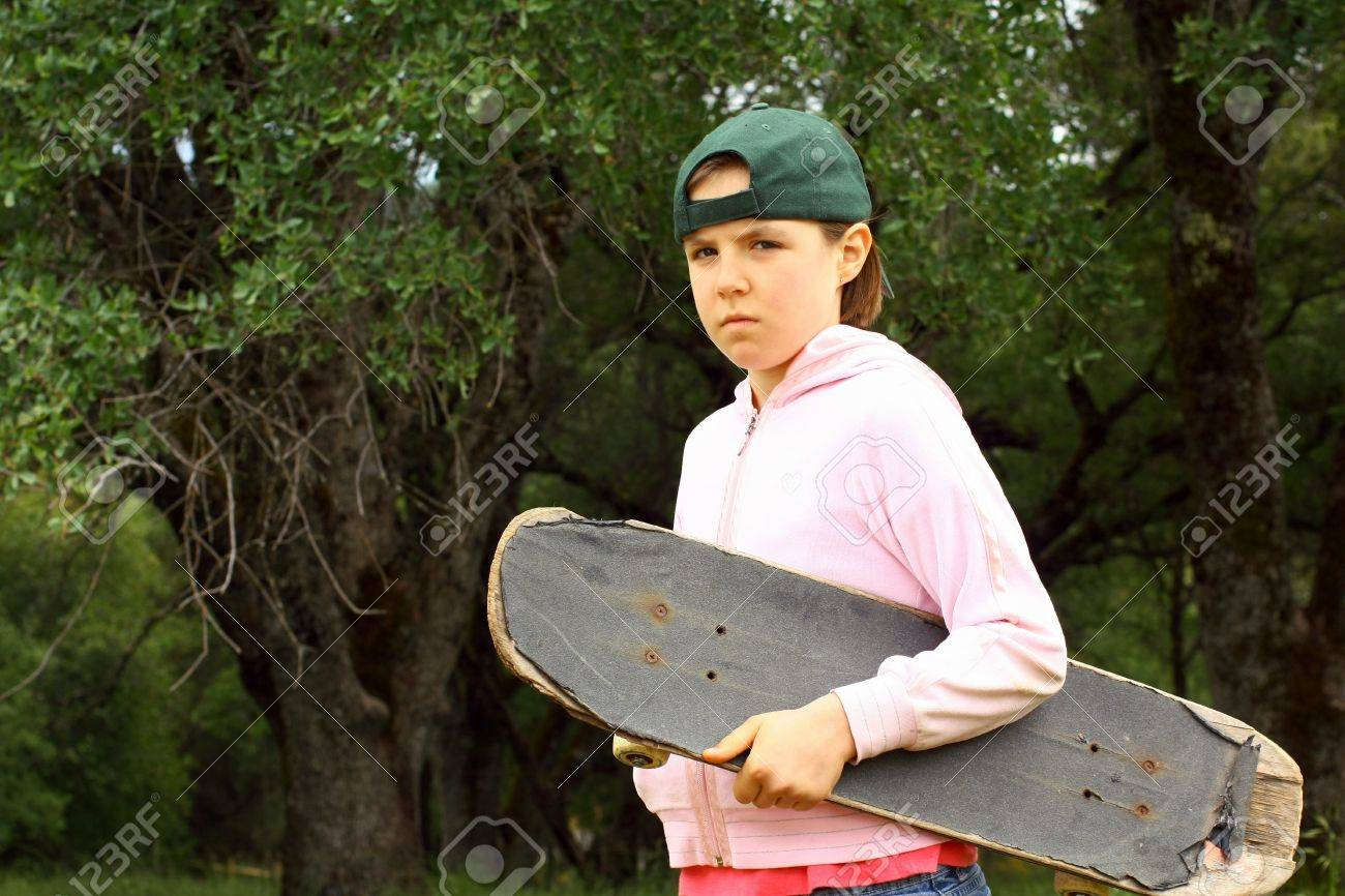 Young girl with well used skateboard Stock Photo - 9741183