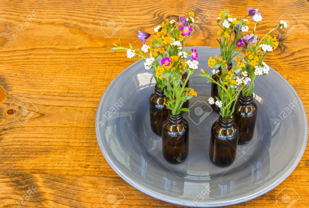 Gray Plate With Small Vases With Flowers Sitting on Wooden Table Stock Photo - 77147577 & Gray Plate With Small Vases With Flowers Sitting On Wooden Table ...