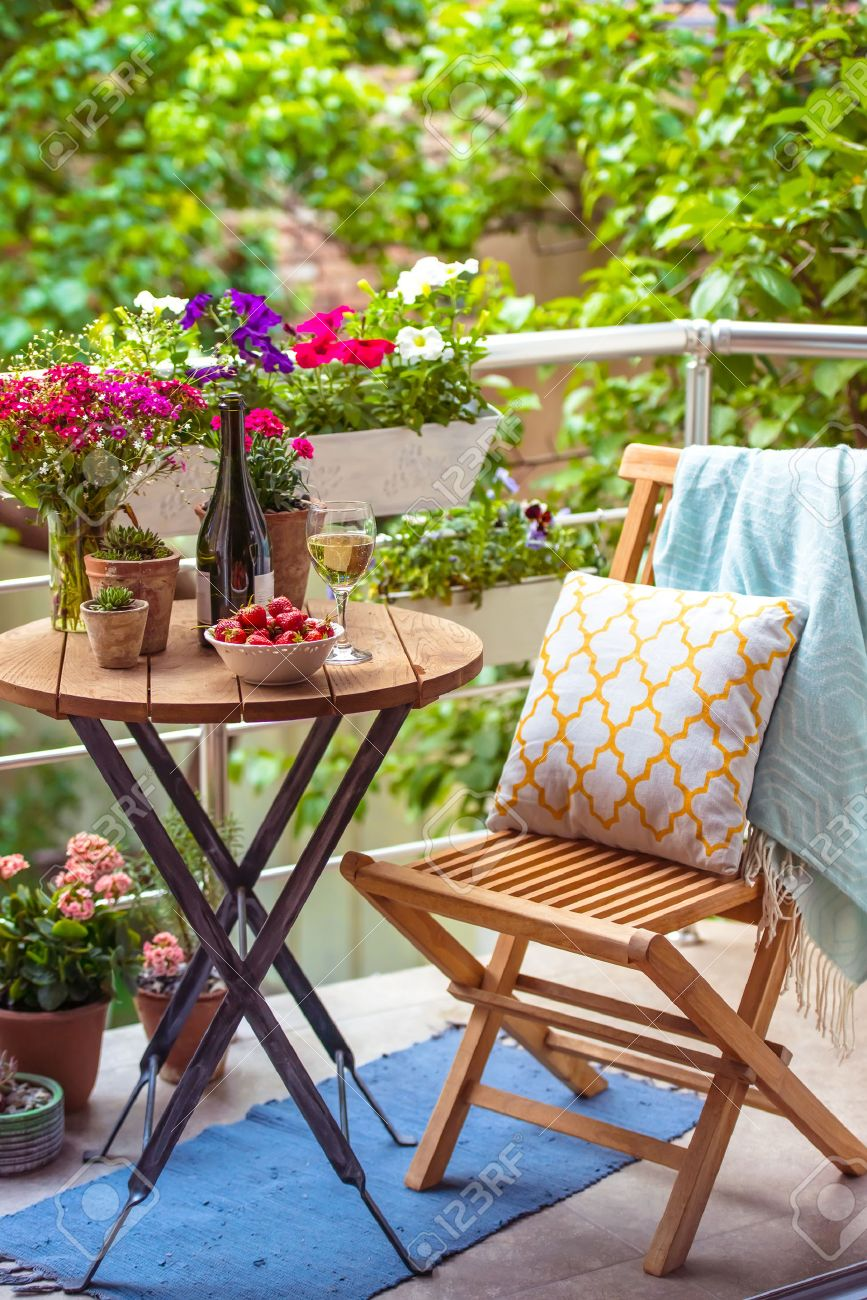 Beautiful Terrace Or Balcony With Small Table, Chair And Flowers Stock  Photo   40623937