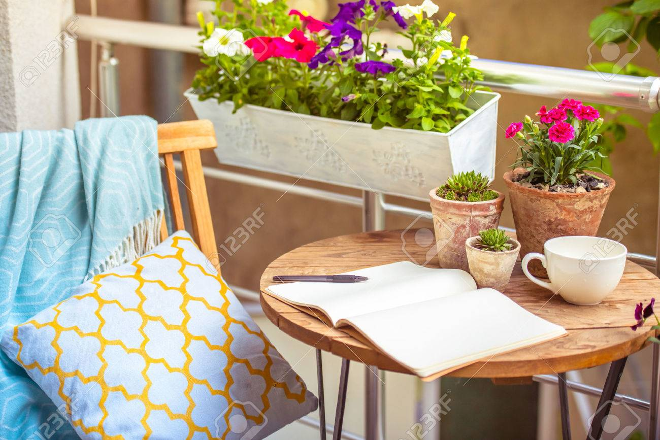 Beautiful Terrace Or Balcony With Small Table, Chair And Flowers Stock  Photo   40624047
