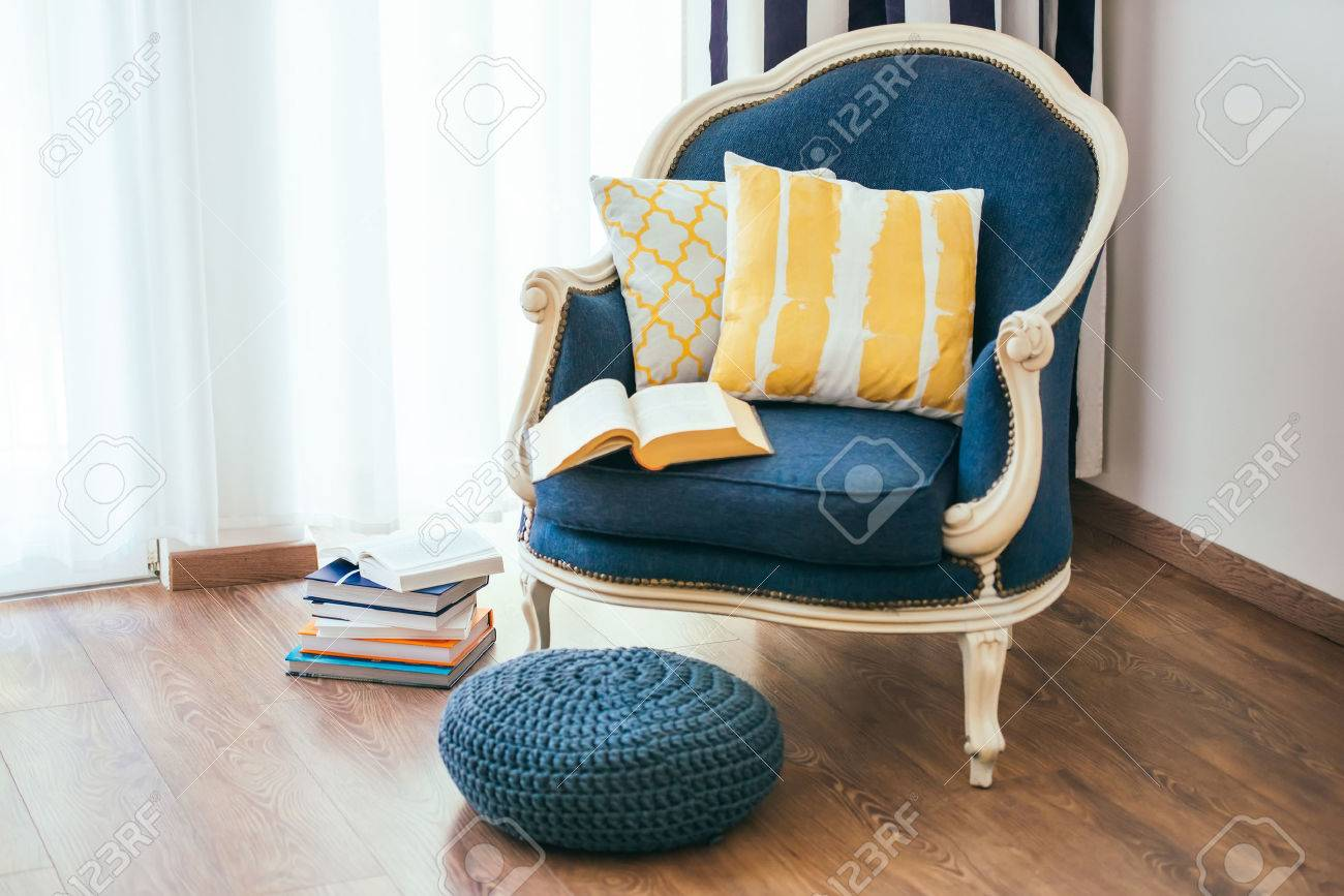 Cozy Armchair With Open Book And Decorative Pillows. Interior And Home  Decor Concept Stock Photo