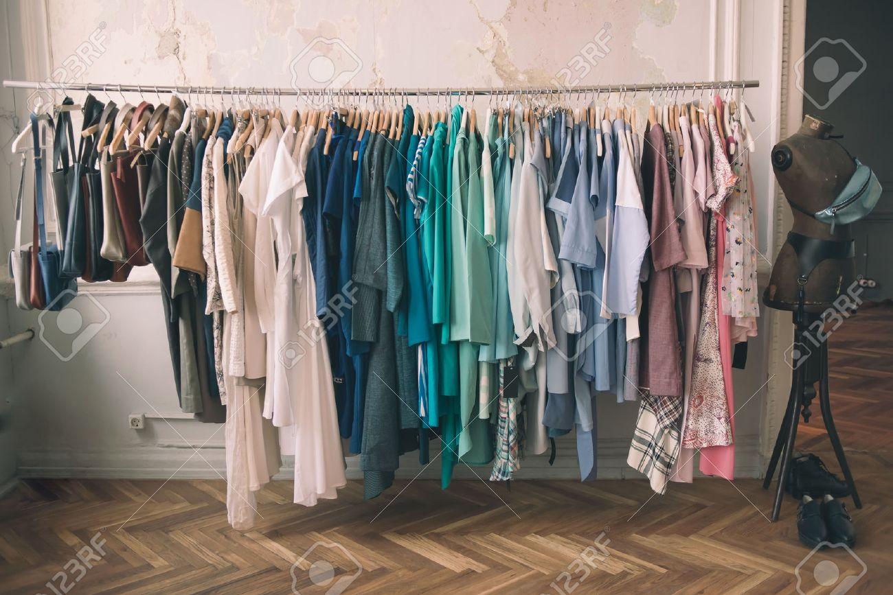 Colorful women's dresses on hangers in a retail shop. Fashion and shopping concept. Toned picture Stock Photo - 50537707