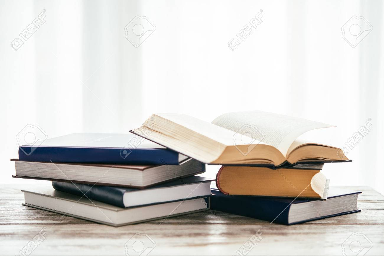 Pile of books on wooden table. Education and reading concept - 55417089