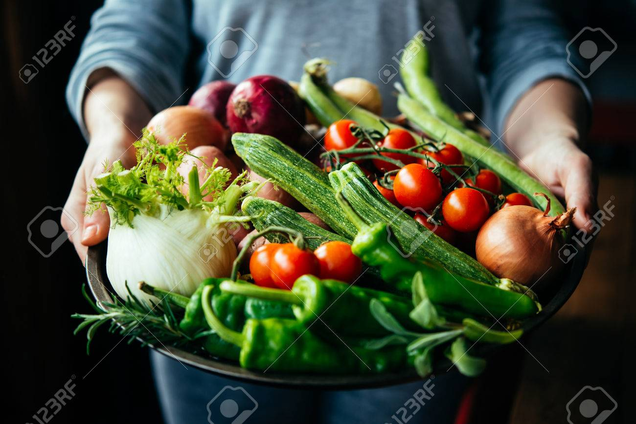 Hands holding big plate with different fresh farm vegetables. Autumn harvest and healthy organic food concept - 58460115