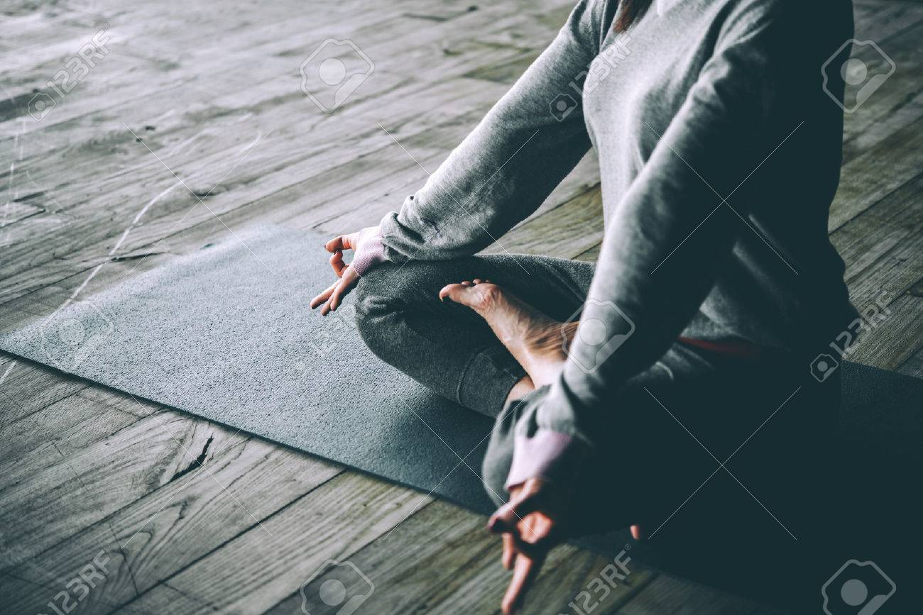 Young woman meditates while practicing yoga. Freedom concept. Calmness and relax, woman happiness. Toned picture - 58510615