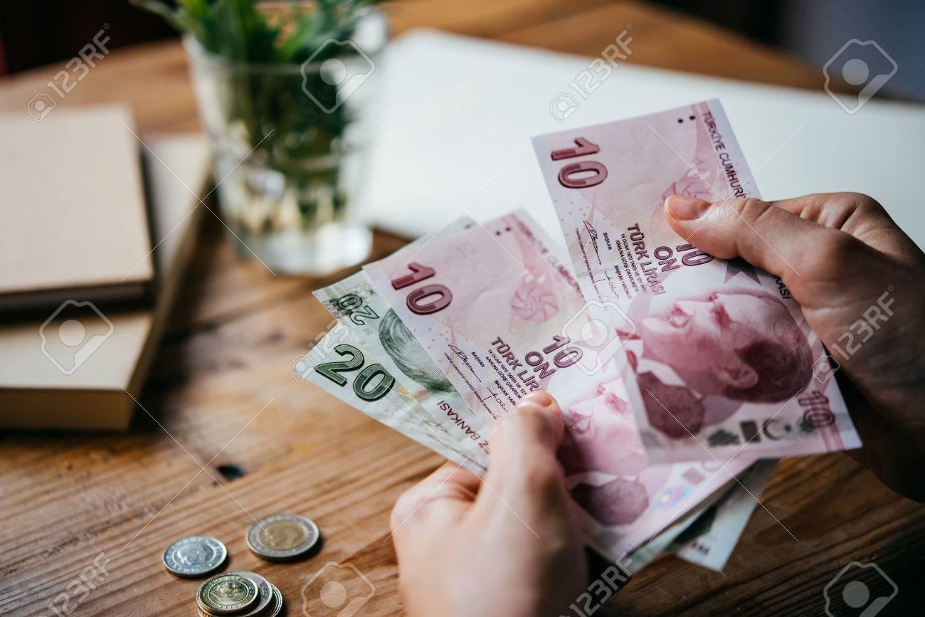 Hands holding turkish lira bills - 58513486