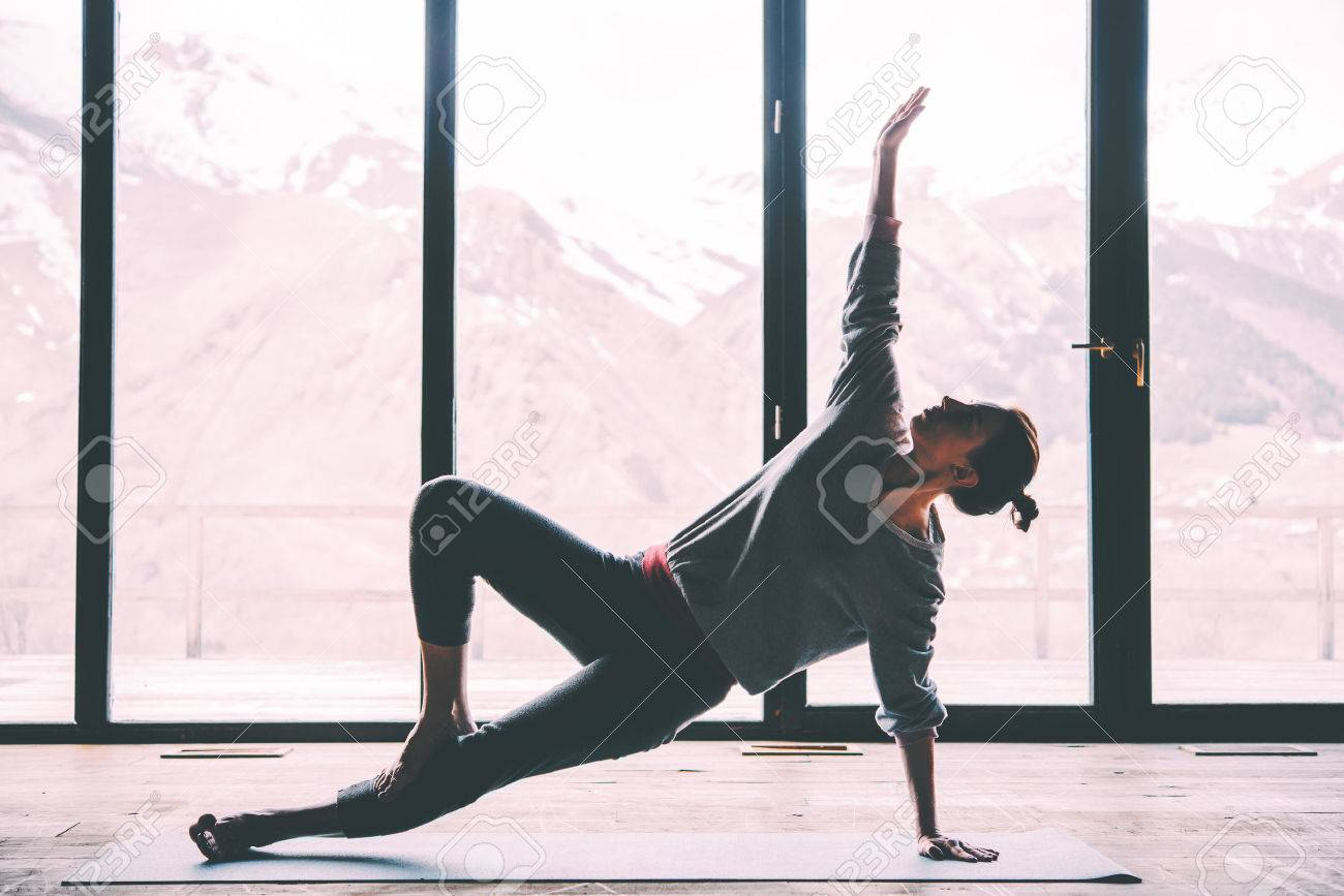 Young beautiful woman practicing yoga with mountain view in the background. Wellness concept. Calmness and relax, woman happiness. Toned picture - 60683474