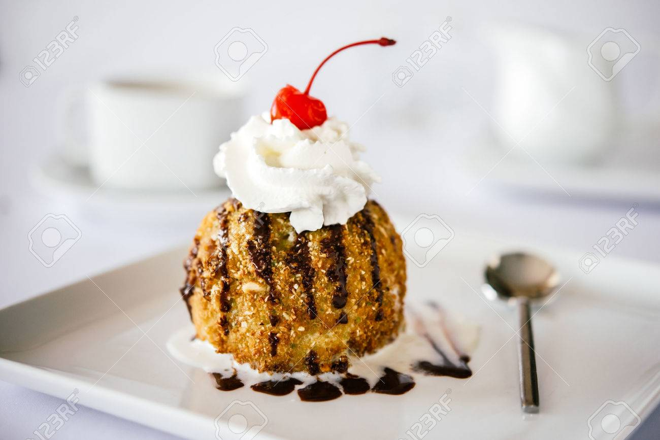 Fried ice cream served on white plate - 61193772