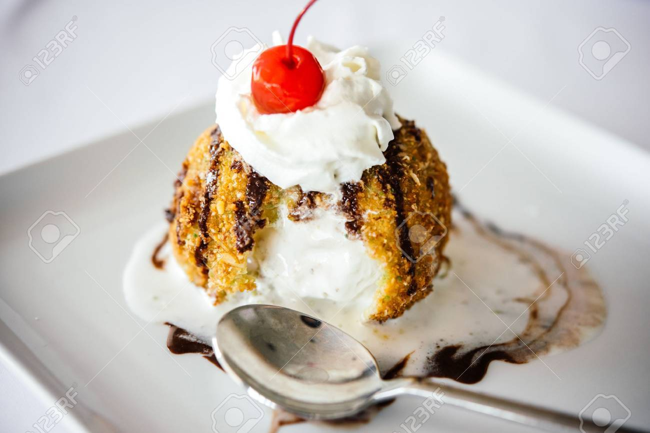 Fried ice cream served on white plate - 61193773