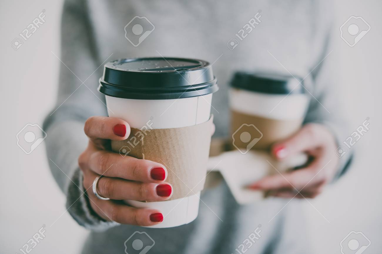 Two take-away cupsof coffee in hands. Toned image - 87845304