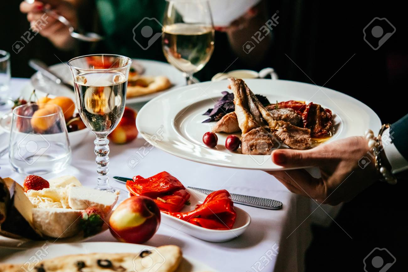 Dinner with friends of family served in a restaurant. - 93300959