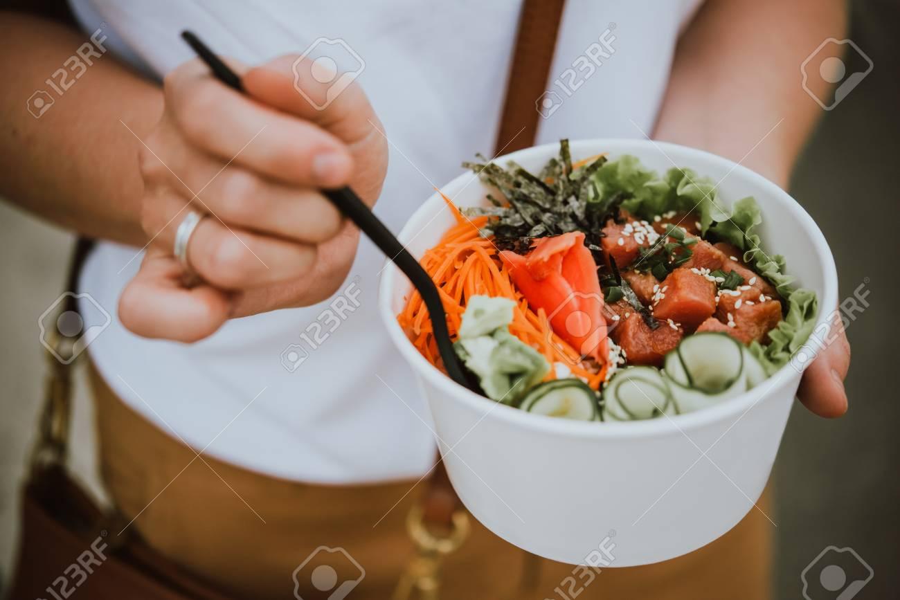 Poke bowl - raw fish salad served as an appetizer, Hawaiian cuisine - 94803055