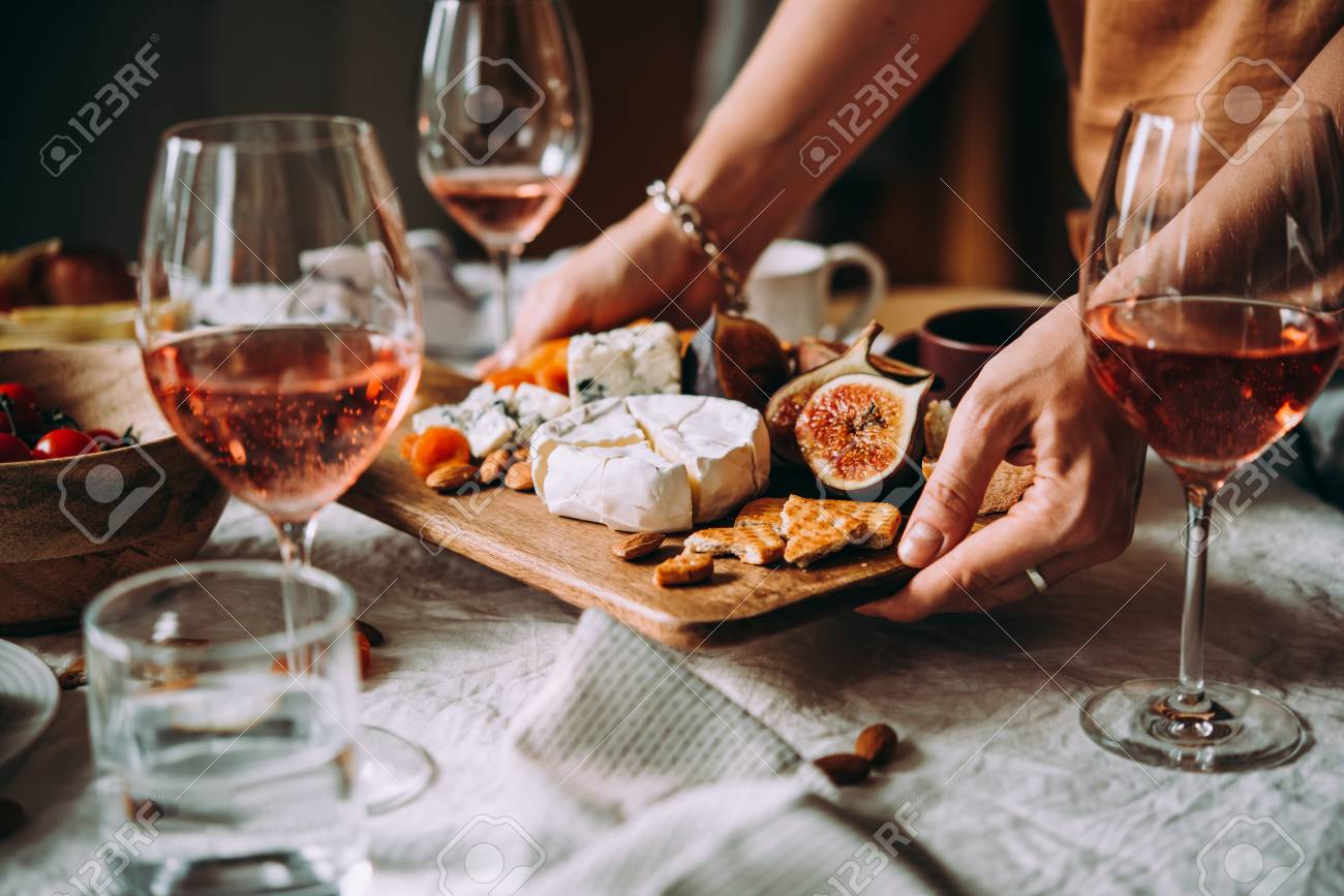 Offering appetizers at a friendly party. Dinner or aperitivo party concept. - 109931633