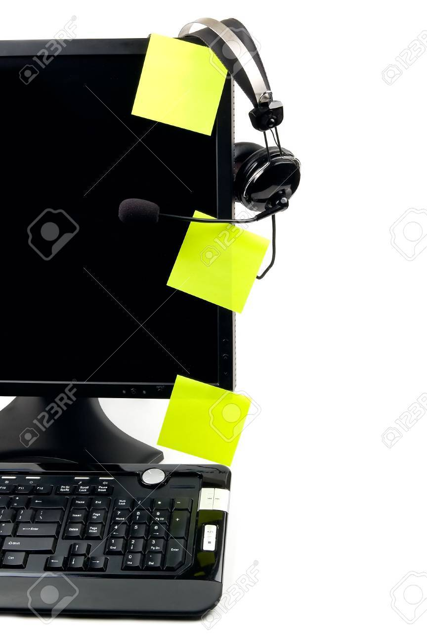 Computer with VOIP headset hanging on the screen, isolated on white background. Internet communications, VOIP (Voice Over Internet Protocol), call-center concepts. Stock Photo - 6450450