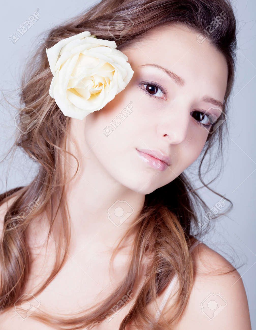 Girl with rose flower in hair Stock Photo - 12326289