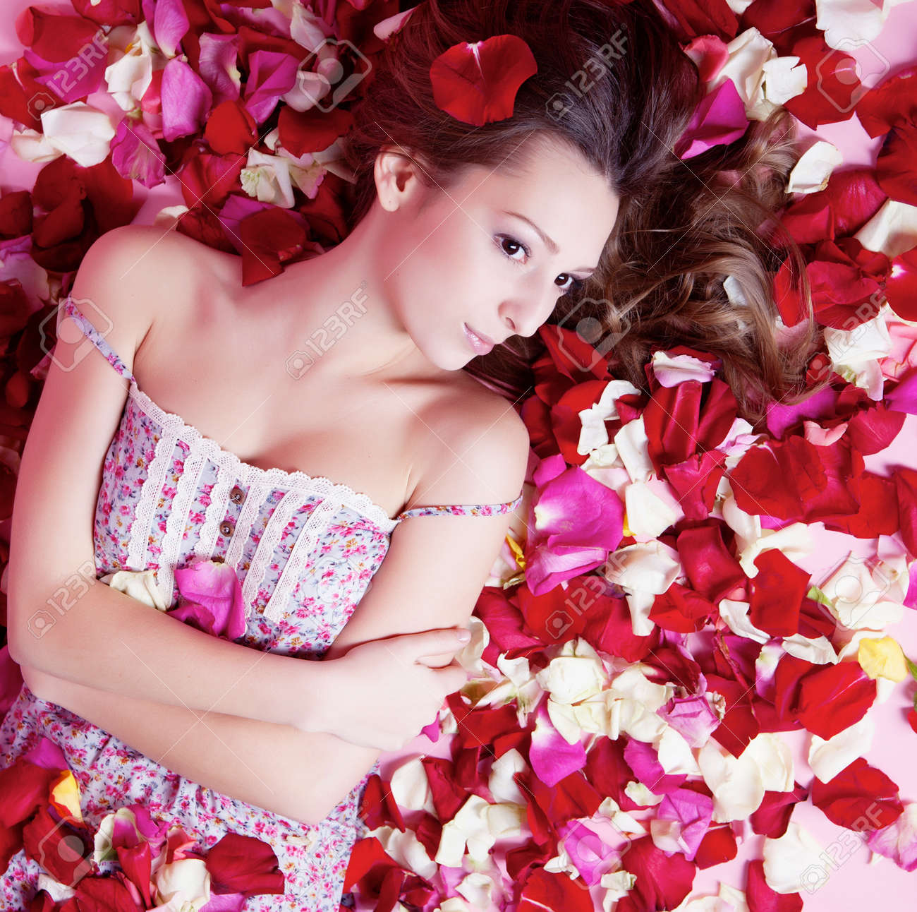 Beautiful girl with rose petals Stock Photo - 12604275