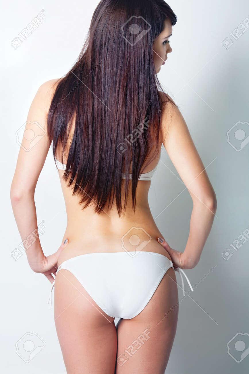 Girl in white swimsuit in studio Stock Photo - 12604347