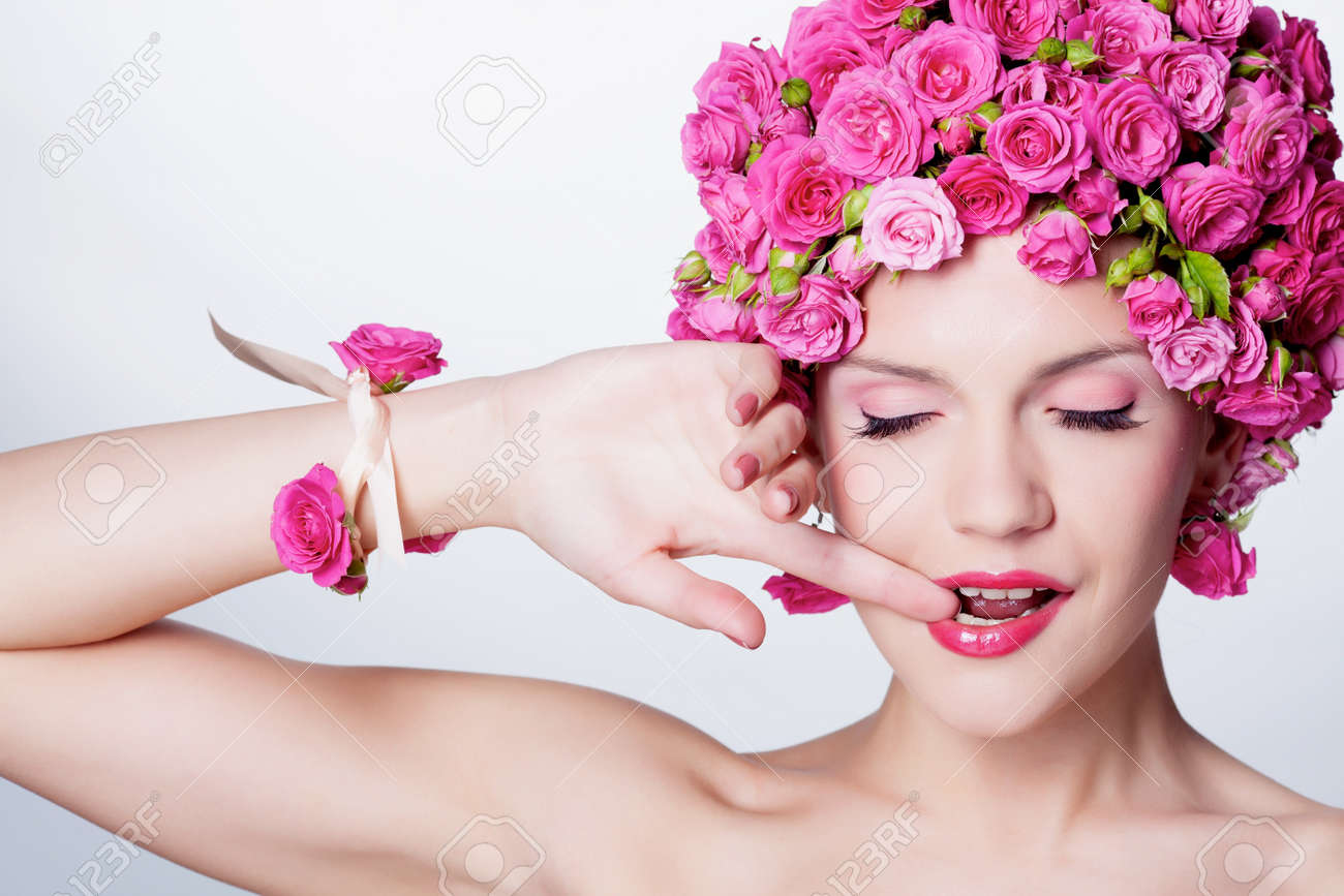 Young girl with pink rose flower in hair Stock Photo - 13859320