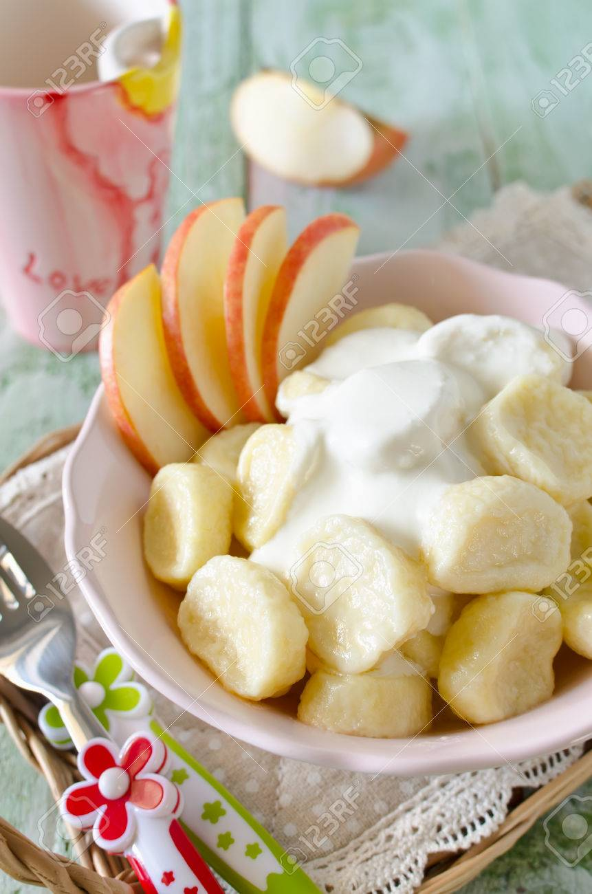 Lazy Dumplings Of Cottage Cheese With Sour Cream And Apples. Breakfast For  Children Stock Photo