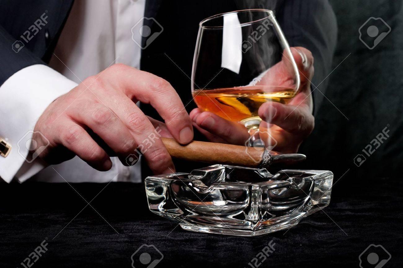 Man smoking cigar and drink cognac Stock Photo - 6854365